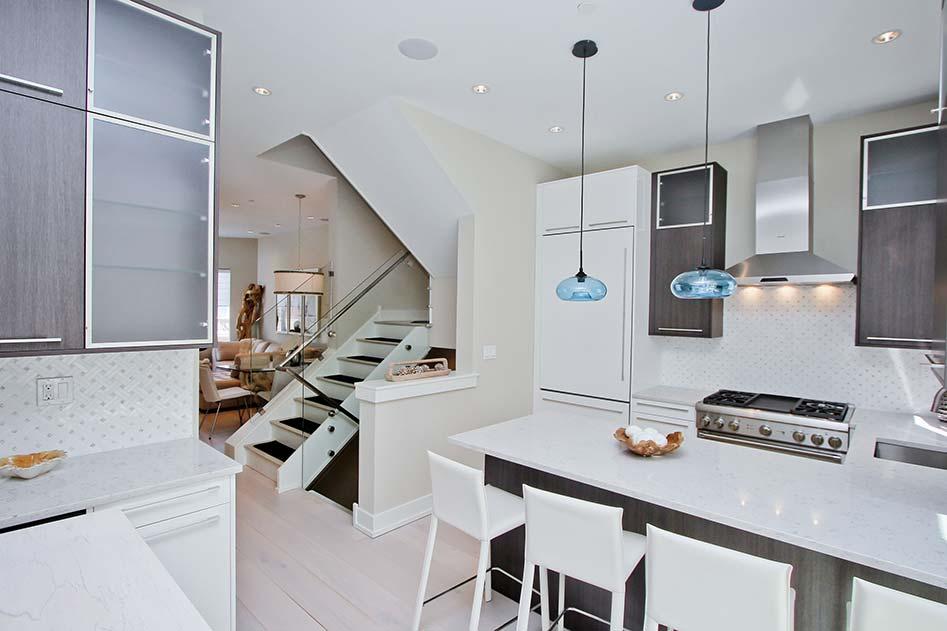 brith white kitchen with dark wood cabinets