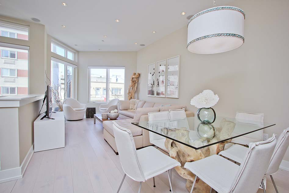 bright white dining room and living room