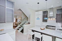 bright white kitchen would wooden cabinets