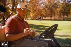 golfer checking his score