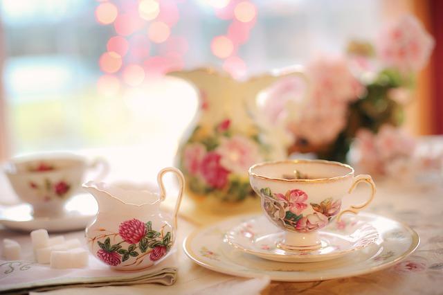 tea set on a table in a garden