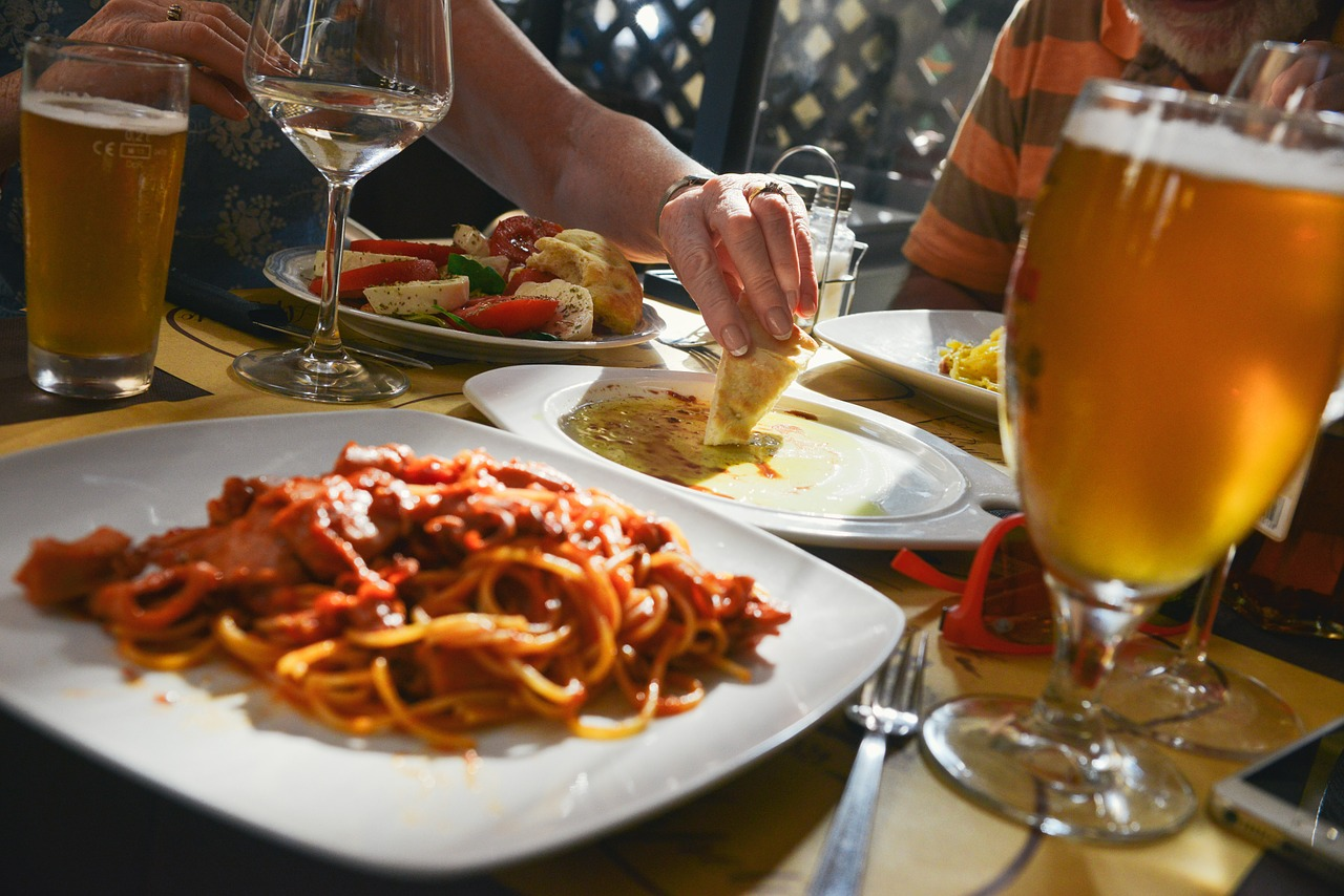 Plate of pasta on a dinner table.