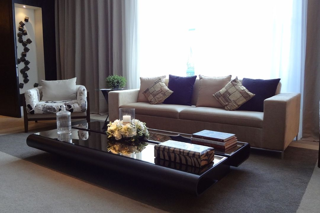 luxury living room with candles on table