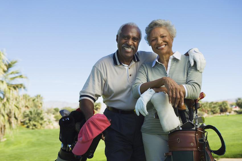 active couple golfing