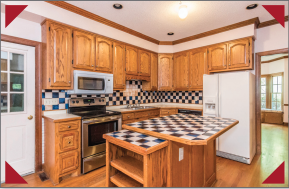 Kitchen with outdated checkerboard cabinets and backsplash.