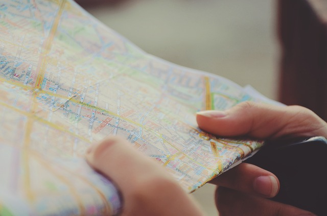 person looking at a map of unfamiliar area