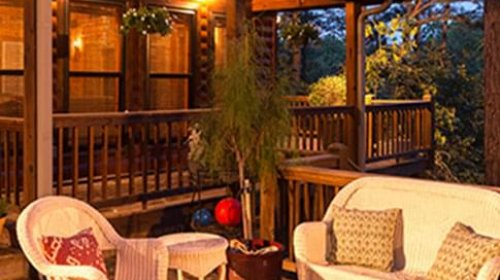 Log cabin porch with comfortable chairs