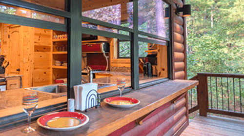 Log cabin with outdoor eating counter