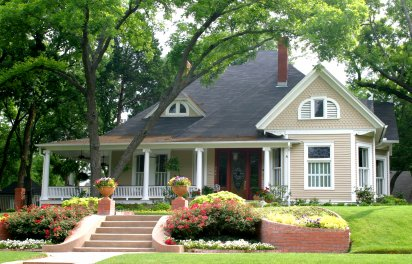 Home with front porch and green lawn