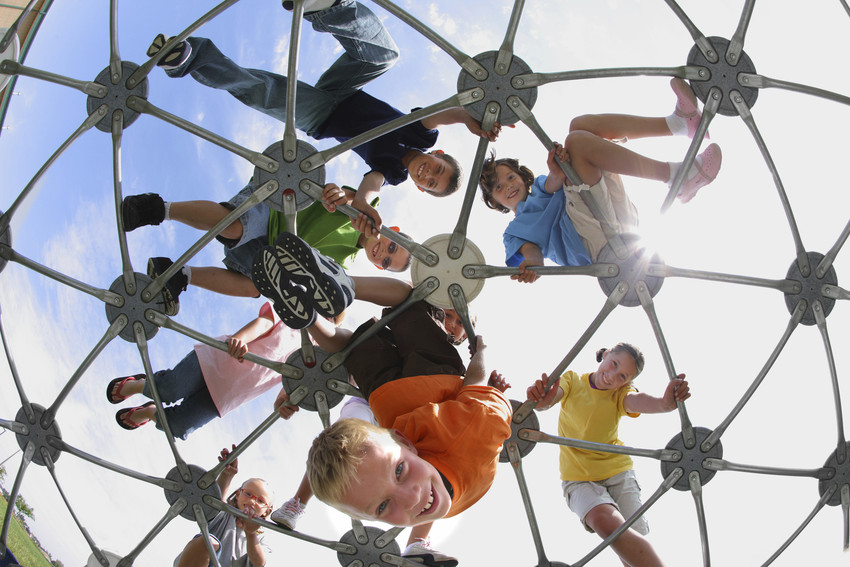 young children playing on a playground structure
