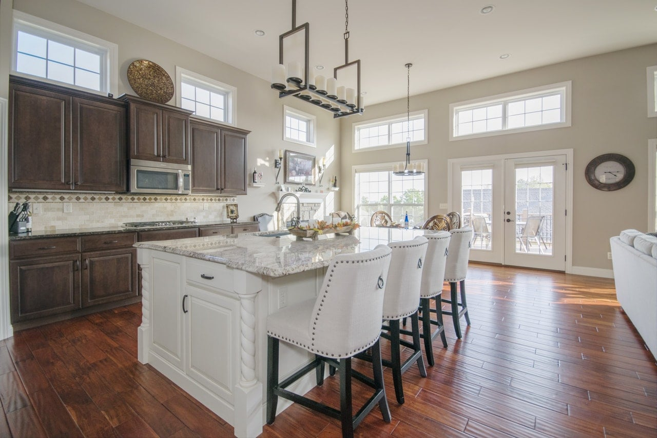Beautiful kitchen interior with white stools.