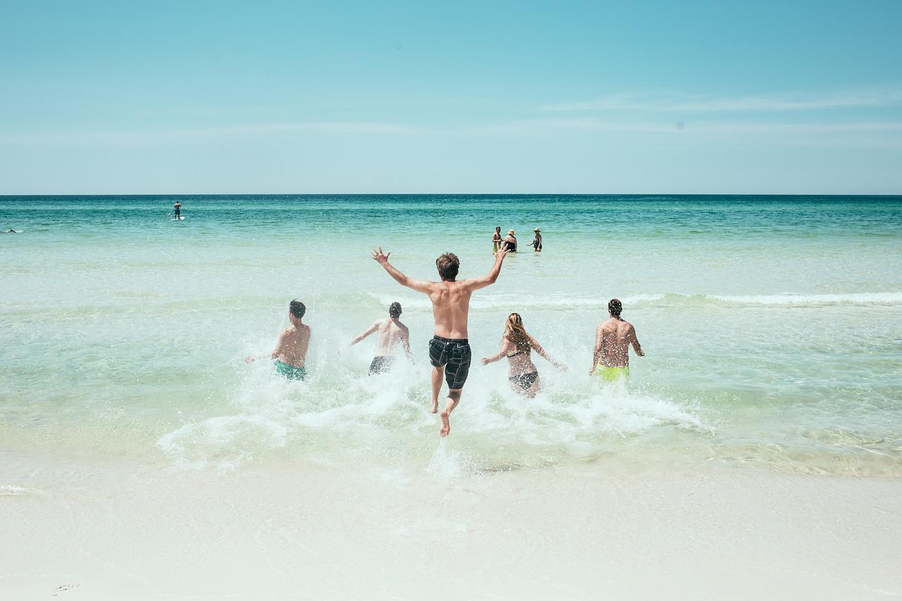 Kids running into the ocean.