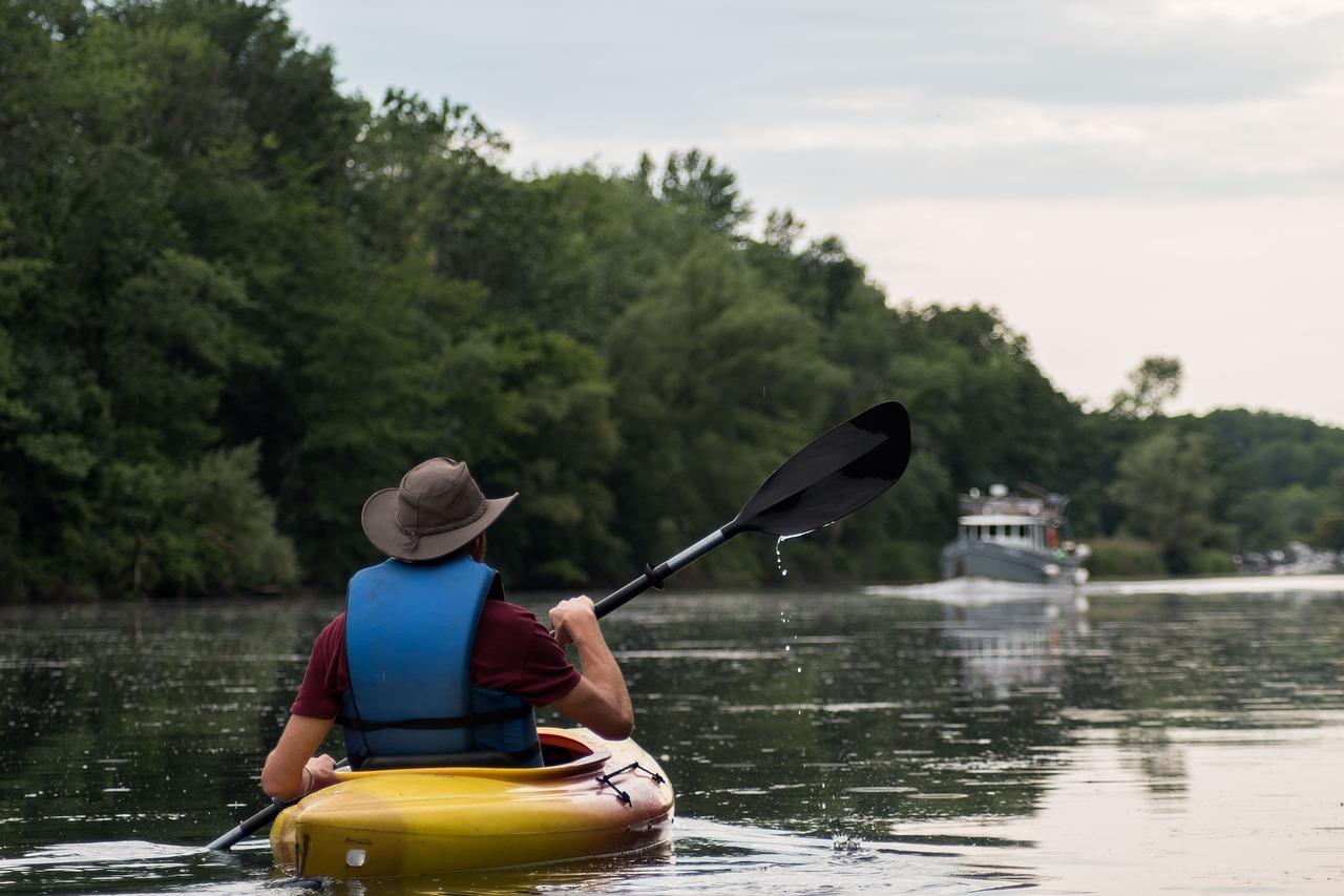 Man kayaking in a river.