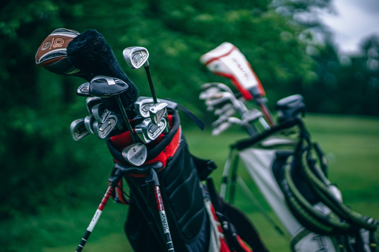 Two bags of golf clubs.