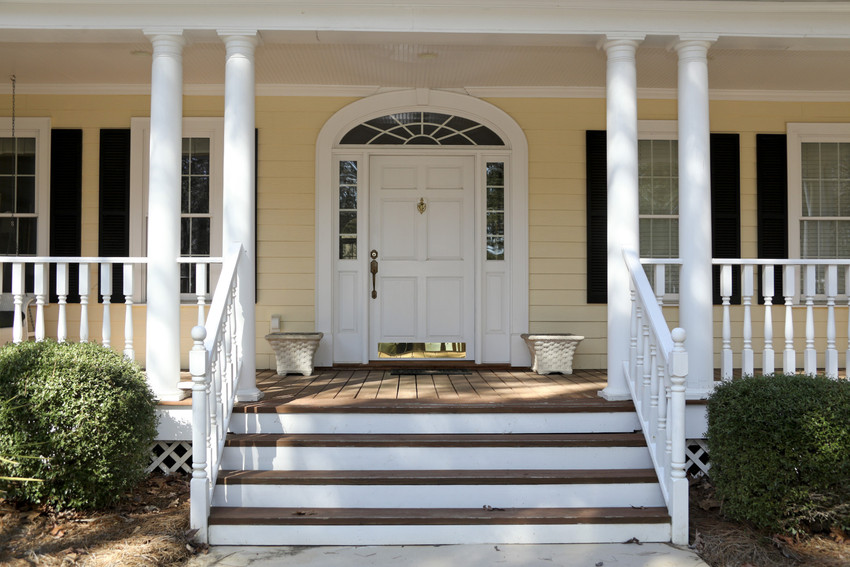 the front porch and front door of a beautiful home