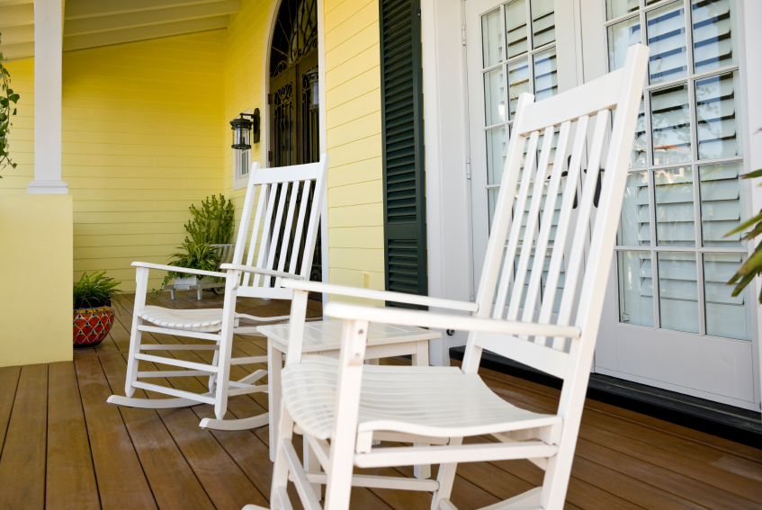 white rocking chairs on a front porch