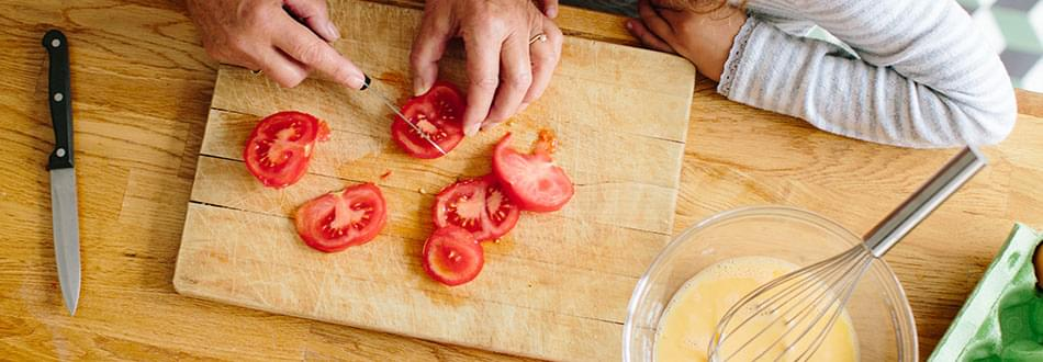 Cutting tomatoes on cutting board