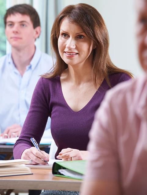 Women taking notes in class
