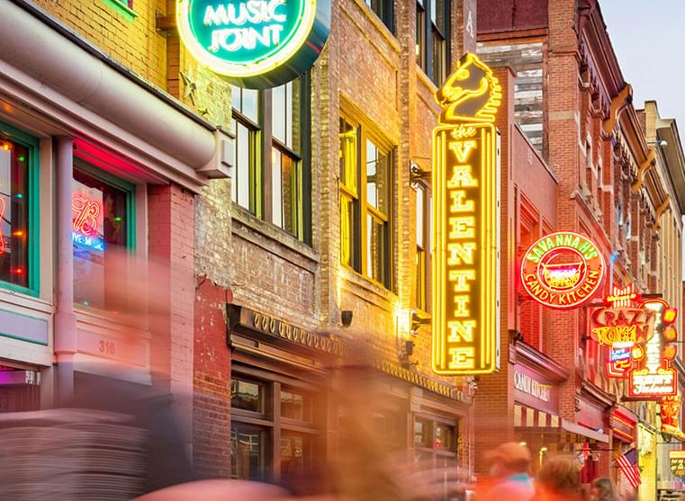 Nashille street with neon signs for music and restaurants