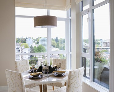 Dining nook in a corner with large windows