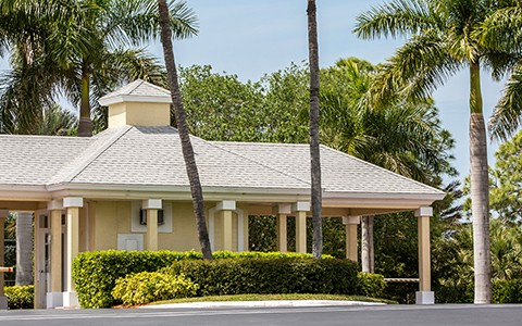 Community gatehouse with palm trees