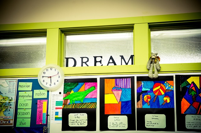 """Classroom board with """"DREAM"""" header on it."""