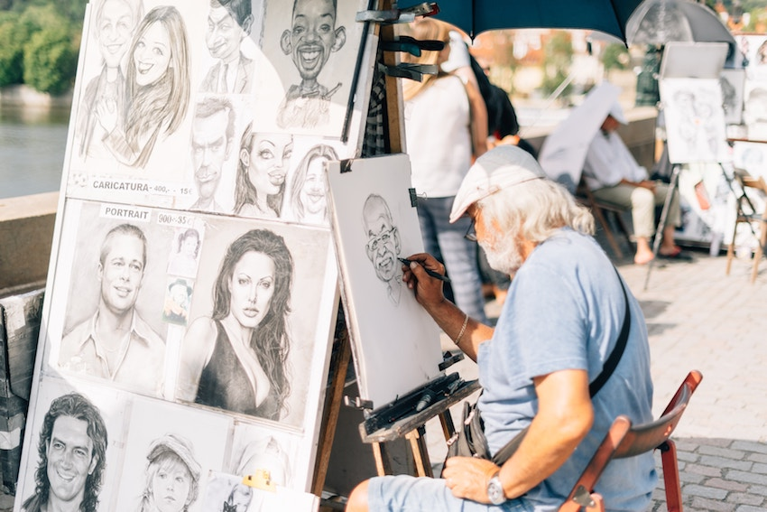 artist drawing cartoon faces