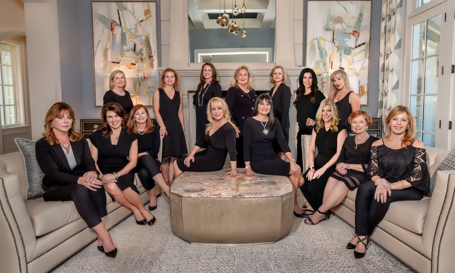 Team photo in luxurious living area