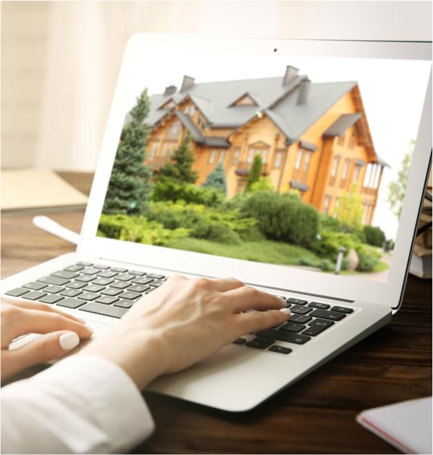 person viewing home photo on laptop