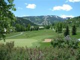 The green fairways and sand traps of Beaver Creek Golf Course.