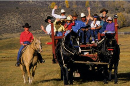 kids and parents on a ranch ride