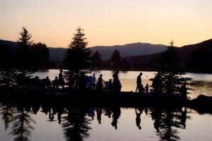 People walking along a lake in Avon, CO.