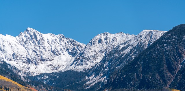 Snow-covered mountain peaks in Colorado.
