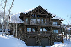 A mountain lodge covered in snow.