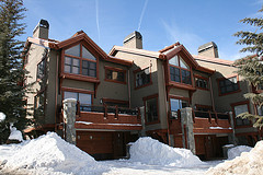 View of exterior of Elk Track Townhomes with snowdrifts nestled against the buildings.