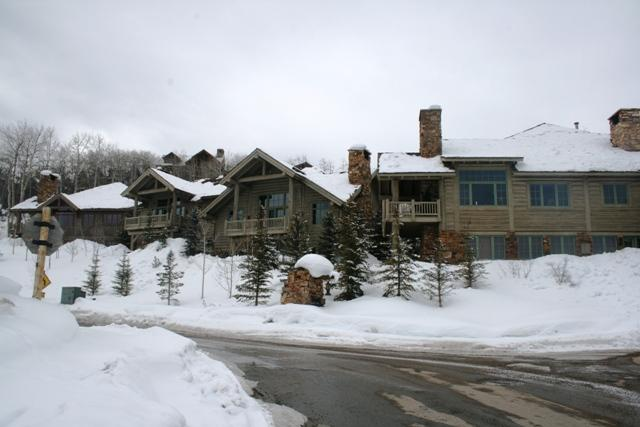 Snow-covered mountain lodges overlooking snowy hillsides.