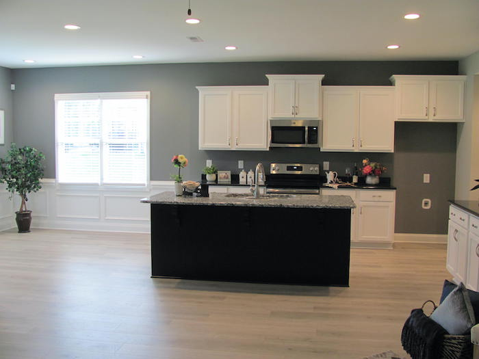 Kitchen with island and dining