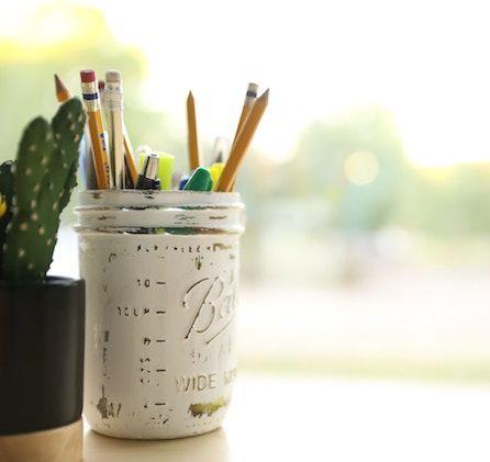 mason jar with pencils in it