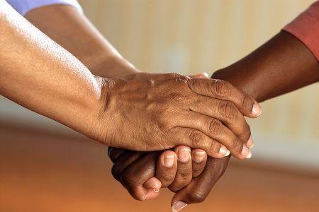 neighbors holding hands
