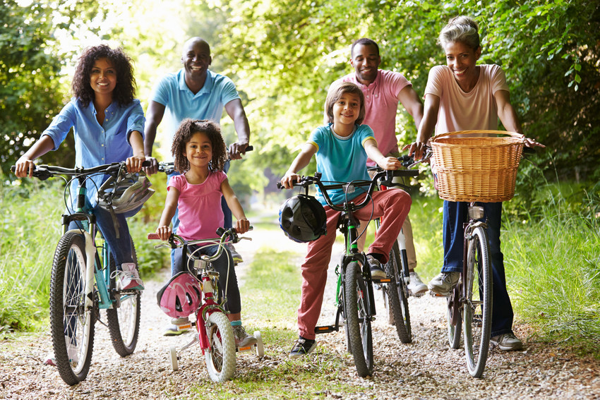 residents bike riding in a park