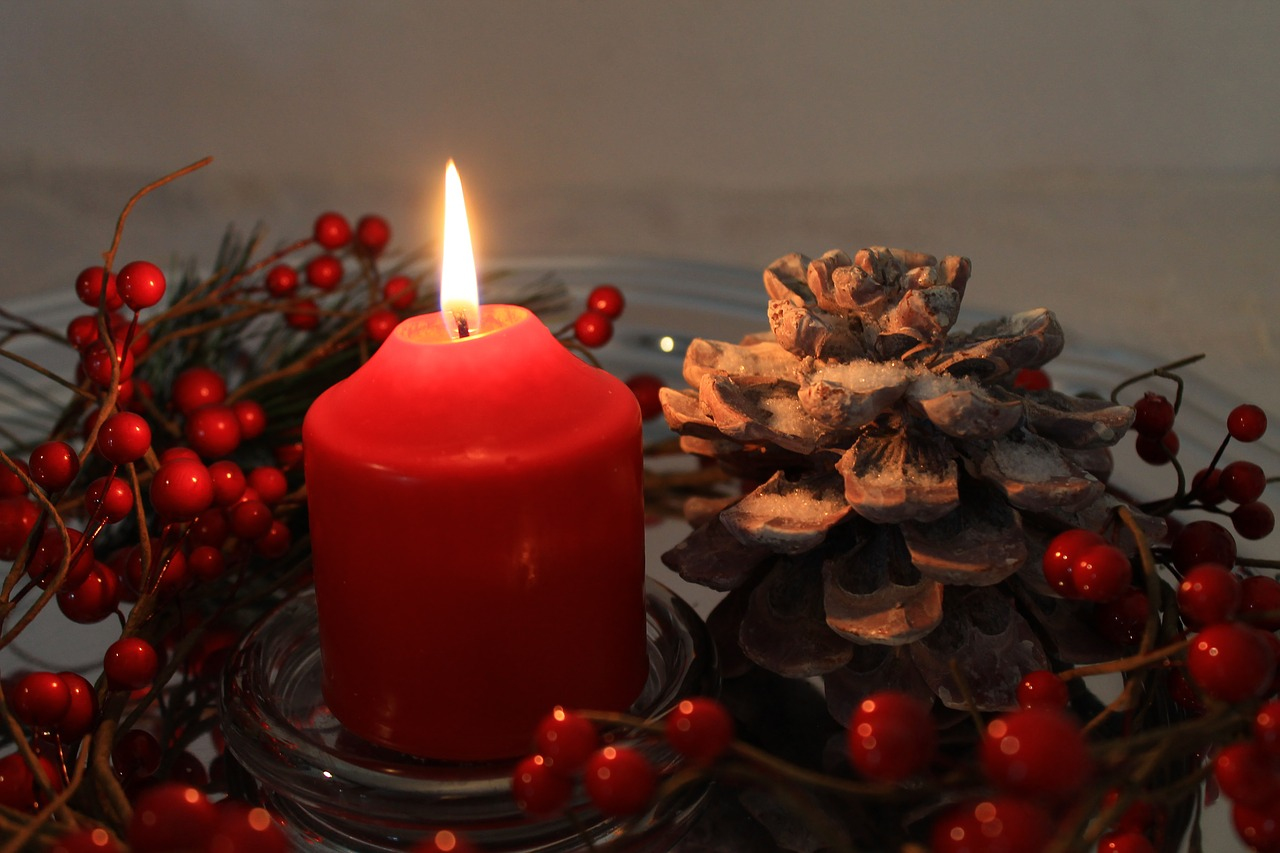 Candle and pine cones.