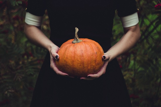 woman holding a pumpkin
